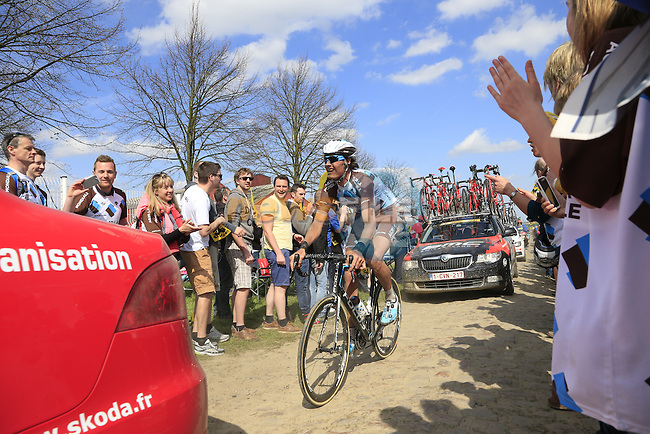 The peloton including Johan Van Summeren (BEL) AG2R La Mondiale tackle Sector 10 Mons-en-Pevele during the 113th edition of the Paris-Roubaix 2015 cycle race held over the cobbled roads of Northern France. 12th April 2015.<br /> Photo: Eoin Clarke www.newsfile.ie