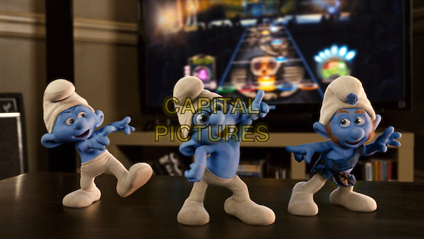 Grouchy (George Lopez), Brainy (Fred Armisen) and Gutsy Smurf (Alan Cumming).in The Smurfs.*Filmstill - Editorial Use Only*.CAP/FB.Supplied by Capital Pictures.