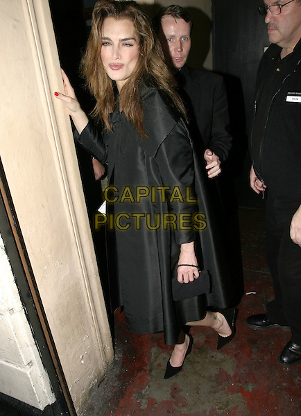 """BROOKE SHIELDS.Leaving the Stage Door of the Adelphi Theatre after her first night on stage as Roxie Heart in """"Chicago"""", .London, April 28th 2005..full length funny leaning Sheilds drunk.Ref: AH.www.capitalpictures.com.sales@capitalpictures.com.©Adam Houghton/Capital Pictures."""