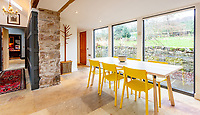 BNPS.co.uk (01202) 558833. <br /> Pic: Strutt&Parker/BNPS<br /> <br /> Kitchen dining table with garden views. <br /> <br /> Have Nessie for a neighbour...<br /> <br /> A beautifully-restored 19th century farmstead just minutes from Loch Ness with stunning Highland views is on the market for £675,000.<br /> <br /> The Steading is in the ancient village of Dores and has been lovingly restored and transformed to create a stylish yet cosy home.<br /> <br /> The house is just a few minutes' walk from the beach at Dores and on a clear day from the shore you can see all the way to the opposite end of the iconic loch - 25 miles away at Fort Augustus - which would be a perfect spot to hunt for its famous monster.<br /> <br /> The Steading would be an ideal property for someone looking for a peaceful, rural retreat in the Scottish Highlands, or could be a good investment property to rent out to holidaymakers.