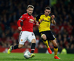 Luke Shaw of Manchester United bursts past Matthew Lund of Burton Albion to score only for it to be ruled out during the Carabao Cup Third Round match at the Old Trafford Stadium, Manchester. Picture date 20th September 2017. Picture credit should read: Simon Bellis/Sportimage