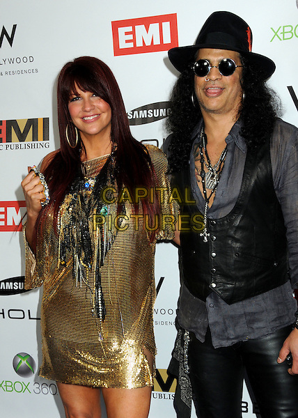 PERLA FERRAR & SLASH (Saul Hudson).EMI Post Grammy Party 2010 held at the W Hollywood Hotel, Hollywood, California, USA, 31st January 2010..half length grey gray hat black leather waistcoat shirt gold dress chain mail chainmail couple married husband wife bracelets sunglasses knuckle duster ring hand grammys .CAP/ADM/BP.©Byron Purvis/Admedia/Capital Pictures