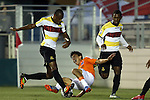 19 April 2014: Carolina's Cesar Elizondo (CRC) (center) is fouled in the penalty area by Fort Lauderdale's Chris Nurse (GUY) (left) and Darnell King (right) leading to the game's first goal. The Carolina RailHawks played the Fort Lauderdale Strikers at WakeMed Stadium in Cary, North Carolina in a 2014 North American Soccer League Spring Season match. Carolina won the game 4-1.