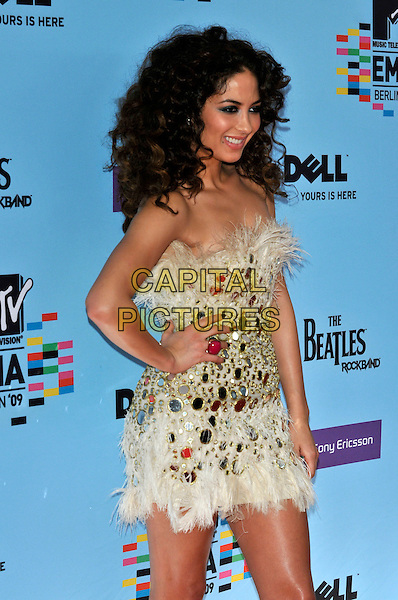 ELENA PAPARIZOU.during the MTV Europe Music Awards 2009 at the O2 World Arena in Berlin, Germany, November 5th 2009..arrivals EMA EMAs half length corset shiny gold strapless hands on hips bustier pink ring embellished feather feathers dress .CAP/PL.©Phil Loftus/Capital Pictures