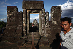 Tourists gather before sunset at the top of Phnom Bakheng in Angkor Wat, Cambodia. June 8, 2013.