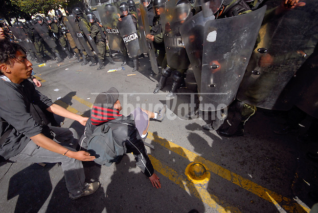 A student of El Alto city falls after trying kicking police oficers in the entry of the US Embassy in La Paz, claiming for this institution and every american to get out of Bolivia, in protest for the US protection to ex President Gonzalo Sanchez de Lozada and two of his ministers.Thousands of supporters of leftist Bolivian President Evo Morales tried to storm the U.S. embassy in La Paz.