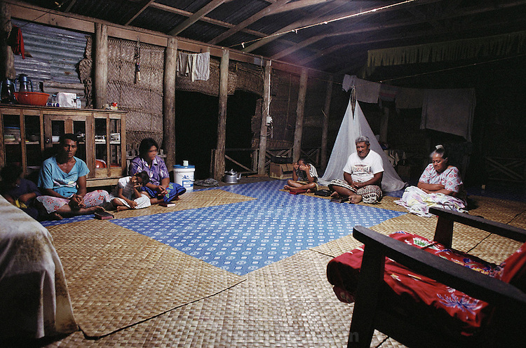 Every morning and evening the Lagavale family reads the Bible, prays and sings. Western Samoa. The Lagavale family lives in a 720-square-foot tin-roofed open-air house with a detached cookhouse in Poutasi Village, Western Samoa. The Lagavales have pigs, chickens, a few calves, fruit trees and a vegetable garden. Material World Project.