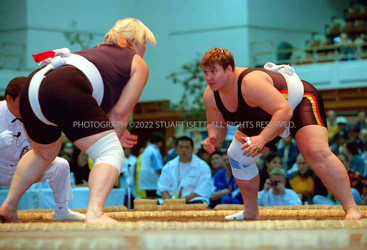 10/26/2001--Hirosaki, Aomori Prefecture, Japan..Sandra Koppemn of Germany  (right) at the World internationl sumo tournament...All photographs ©2003 Stuart Isett.All rights reserved.This image may not be reproduced without expressed written permission from Stuart Isett.