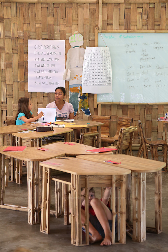 Primary school class. Class agreements are that they will be respectful, work hard, be safe clean and have fun. Everything is made of bamboo or local plants. The Whiteboards are made from recycled windscreens and shockproof glass painted white on the inside.<br />