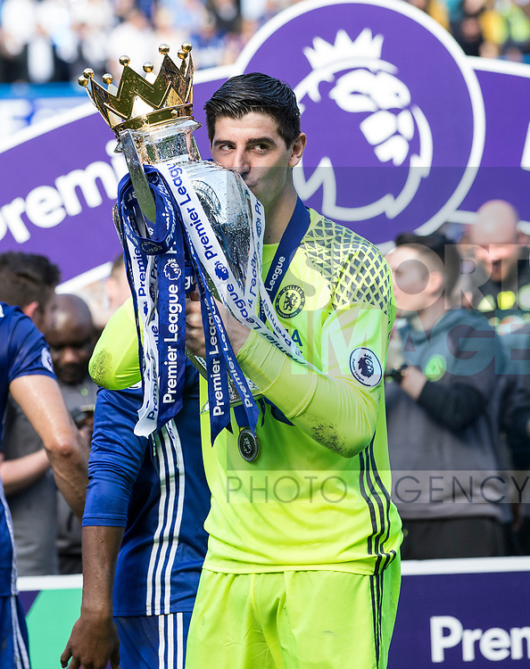 Chelsea's Thibaut Courtois celebrates with the trophy during the Premier League match at Stamford Bridge Stadium, London. Picture date: May 18th, 2017. Pic credit should read: David Klein/Sportimage
