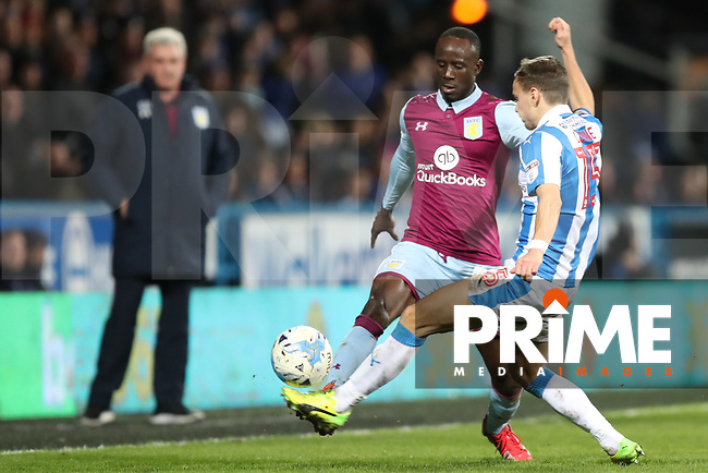 Albert Adomah of Aston Villa puts the ball down the wing pat Chris Lowe of Huddersfield Town during the Sky Bet Championship match between Huddersfield Town and Aston Villa at the John Smith's Stadium, Huddersfield, England on 7 March 2017. Photo by Thomas GADD / PRiME Media Image.