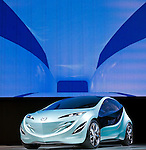 Mazda Motor Corp.'s Kiyora concept car is displayed during a pre-opening day for the media two days before the start of the 41st Tokyo Motor Show 2009 at Makuhari Messe in Chiba, Japan on Wed., Oct. 21 2009..Photographer: Robert Gilhooly
