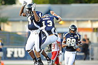 9 October 2010:  FIU quarterback Wesley Carroll (13) and wide receiver T.Y. Hilton (4) celebrate Carroll's fourth-quarter touchdown as the FIU Golden Panthers defeated the Western Kentucky Hilltoppers, 28-21, at FIU Stadium in Miami, Florida.
