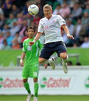 FUSSBALL   1. BUNDESLIGA   SAISON 2011/2012    2. SPIELTAG VfL Wolfsburg - FC Bayern Muenchen      13.08.2011 Bastian SCHWEINSTEIGER (Bayern) am Ball
