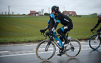 trying to get on a rain jacket can be tricky, as demonstrated by Sir Bradley Wiggins (GBR/Sky)<br /> <br /> 77th Gent-Wevelgem 2015