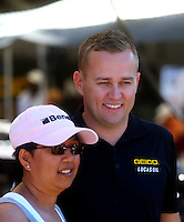 Jul. 26, 2014; Sonoma, CA, USA; A fan poses for a picture with NHRA top fuel driver Richie Crampton during qualifying for the Sonoma Nationals at Sonoma Raceway. Mandatory Credit: Mark J. Rebilas-