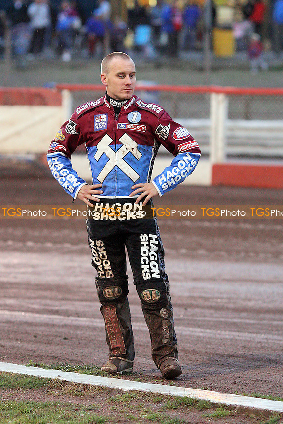 Lee Richardson of Lakeside checks the track as rain falls - Lakeside Hammers vs Poole Pirates - Elite League Speedway at Arena Essex Raceway - 22/07/11 - MANDATORY CREDIT: Gavin Ellis/TGSPHOTO - Self billing applies where appropriate - 0845 094 6026 - contact@tgsphoto.co.uk - NO UNPAID USE.