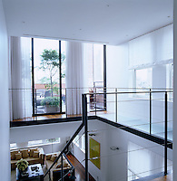 A steel and glass walkway leads to the master bedroom and terrace