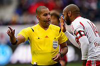 Referee Juan Guzman talks with Thierry Henry (14) of the New York Red Bulls. The New York Red Bulls and Chivas USA played to a 1-1 tie during a Major League Soccer (MLS) match at Red Bull Arena in Harrison, NJ, on March 30, 2014.
