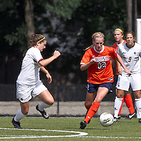 University of Virginia midfielder/defender Shasta Fisher (12) brings the ball out as Boston College midfielder/defender Alicia Blose (13) closes. Boston College defeated University of Virginia, 2-0, at the Newton Soccer Field, on September 18, 2011.