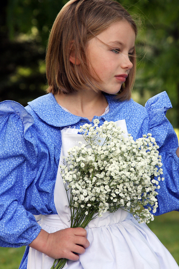 A young girl with white flowers