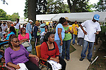 Family members wait near the entrance to find out the location of relatives who were buried before 2001 near the entrance to the Burr Oak Cemetery, one of the oldest and most historic black American cemeteries on the outskirts of Cook County, the same day four cemetery managers and caretakers were arrested on felony charges of disinterring and dismembering bodies at the cemetery in order to resell the plots to unsuspecting members of the public in Alsip, Illinois on July 9, 2009. In recent months, many older graves had reportedly been moved and relocated within the cemetery grounds adding to the forensics confusion.