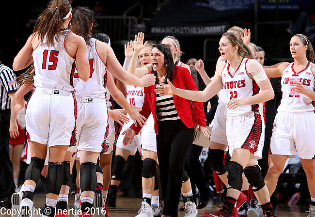 SIOUX FALLS, SD - MARCH 5:  Coach Amy Williams and the South Dakota bench celebrate during their 2016 Summit League Tournament against Denver. (Photo by Dave Eggen/Inertia)
