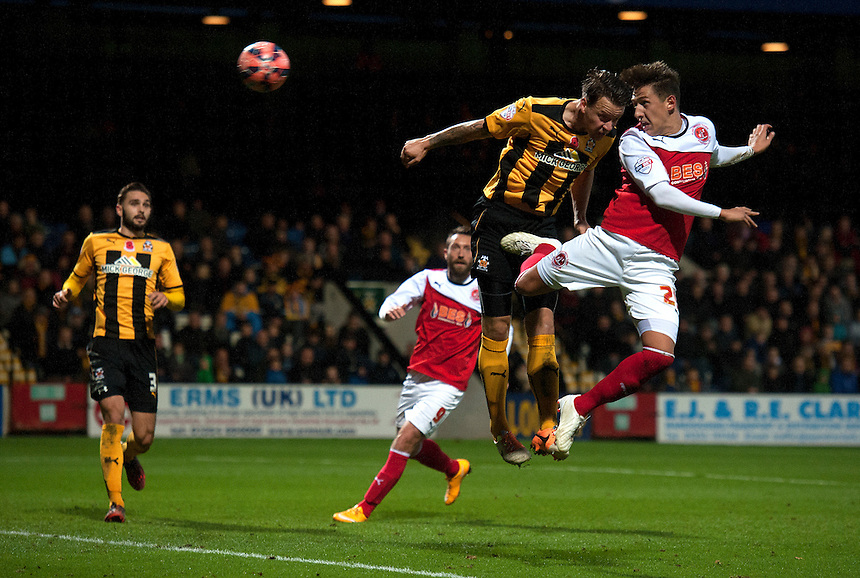 Fleetwood Town's Tom Hitchcock beats Cambridge United's Josh Coulson to the ball but sees this powerful header saved by Cambridge United's goalkeeper Chris Dunn late in the game<br /> <br /> Photographer Stephen White/CameraSport<br /> <br /> Football - FA Challenge Cup First Round - Cambridge United v Fleetwood Town - Saturday 8th November 2014 - R Costings Abbey Stadium - Cambridge<br /> <br />  &copy; CameraSport - 43 Linden Ave. Countesthorpe. Leicester. England. LE8 5PG - Tel: +44 (0) 116 277 4147 - admin@camerasport.com - www.camerasport.com