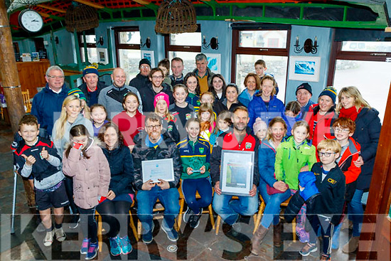 Pictured in Spillanes bar, the Maharees, last Saturday afternoon, local conservation group proudly show their National award for the best beach clean up in Ireland, Clean Coast Ocean Hero Award received in Dublin last Tuesday.