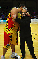 Pero Cameron and Pistons coach Murray McMahon hug after the win during game two of the NBL Final basketball match between the Wellington Saints and Waikato Pistons at TSB Bank Arena, Wellington, New Zealand on Friday 20 June 2008. Photo: Dave Lintott / lintottphoto.co.nz