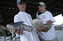 (PHOTO BY CHERYL GERBER)<br /> Fourteen-year-old Sean Dedebant and 15-year-old Jason Vives show off their nearly two-pound catfish at the sixth annual Lake Pontchartrain Basin Foundation Back to the Lake Fishing rodeo, Saturday, May 25, 2002.Southeast Louisiana
