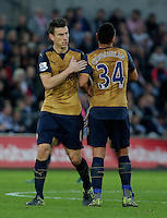 Laurent Koscielny of Arsenal celebrates his goal with team mate Francis Coquelin during the Barclays Premier League match between Swansea City and Arsenal at the Liberty Stadium, Swansea on October 31st 2015