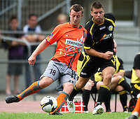 Waikato's Corey Hitchens is pressured by Chris Bale..NZFC soccer  - Team Wellington v Waikato FC at Newtown Park, Wellington. Sunday, 20 December 2009. Photo: Dave Lintott/lintottphoto.co.nz