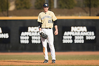 First baseman Matt Conway #25 of the Wake Forest Demon Deacons on defense versus the Xavier Musketeers at Wake Forest Baseball Park March 7, 2010, in Winston-Salem, North Carolina.  Photo by Brian Westerholt / Four Seam Images