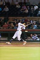Scottsdale Scorpions center fielder Ronnie Dawson (4), of the Houston Astros organization, follows through on his swing during an Arizona Fall League game against the Surprise Saguaros at Scottsdale Stadium on October 15, 2018 in Scottsdale, Arizona. Surprise defeated Scottsdale 2-0. (Zachary Lucy/Four Seam Images)