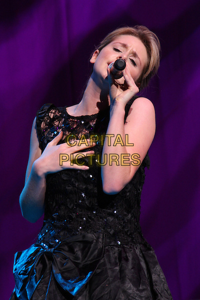 DIANA VICKERS .BRMB Live 2010 at the LG Arena, Birmingham, England..November 27th 2010.half length stage concert live gig performance music black dress funny  lace hand singing.CAP/JIL.©Jill Mayhew/Capital Pictures