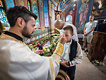 Fr. Marko Bojovich anoints a boy after veneration of the relics of St. Mardarije. <br /> <br /> Patriarchal Divine Liturgy service with His Holiness Irinej to venerate and glorify the relics of St. Mardarije of Libertyville, St. Sava Monastery Church<br /> <br /> #NGMWADiocese<br /> #GlorificationStMardarije, #Chicago, #PatriarchIrinej, #MetropolitanAmphiloije<br /> #SerbianOrthodoxChurch<br /> #www.stsavamonastery.org