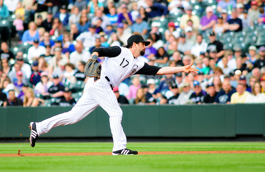 May 30, 2009: Rockies 1st baseman Todd Helton makes an underhand toss for an out at 1st base during a game between the San Diego Padres and the Colorado Rockies at Coors Field in Denver, Colorado. The Rockies beat the Padres 8-7.