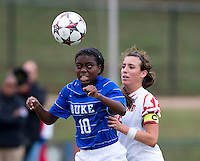 Toni Payne (10) of Duke heads the ball in front of Megan Gibbons (16) of Maryland at Ludwig Field on the campus of the University of Maryland in College Park, MD. DC. Duke defeated Maryland, 2-1.