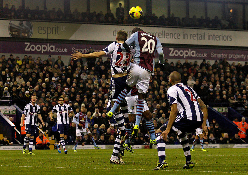 Aston Villa's Christian Benteke misses a headed attempt on goal.<br /> <br /> Photo by James Marsh/CameraSport<br /> <br /> Football - Barclays Premiership - West Bromwich Albion v Aston Villa - Monday 25th November 2013 - The Hawthorns - West Bromwich<br /> <br /> &copy; CameraSport - 43 Linden Ave. Countesthorpe. Leicester. England. LE8 5PG - Tel: +44 (0) 116 277 4147 - admin@camerasport.com - www.camerasport.com
