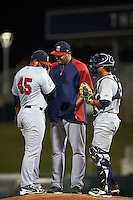 Brevard County Manatees pitching coach David Chavarria (49) talks with pitcher Junior Rincon (45) and catcher Fidel Pena (18) during a game against the Fort Myers Miracle on April 13, 2016 at Hammond Stadium in Fort Myers, Florida.  Fort Myers defeated Brevard County 3-0.  (Mike Janes/Four Seam Images)