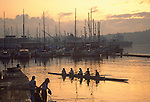 Seattle, Rowing, Workout, women rowers at sunrise leaving the dock in coxed four, Lake Union, Washington State, Pacific Northwest, USA,