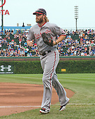 Washington Nationals right fielder Jayson Werth (28) returns to the dugout after the third inning of the game against the Chicago Cubs at Wrigley Field in Chicago, Illinois on Thursday, August 22, 2013.  The Nationals won the game 5 - 4 in thirteen innings.<br /> Credit: Ron Sachs / CNP