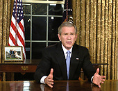Washington, DC - December 18, 2005 -- United States President George W. Bush addressed the Nation from the Oval Office in the White House in Washington, D.C. on December 18, 2005 to speak about the historic election in Iraq last Thursday.  The address is the culmination of a series of four speeches that have addressed the three aspects of United States strategy in Iraq: security, democracy, and reconstruction.  The President outlined the strategy for victory; the progress made, and the challenges ahead.  The President cautioned that there is more testing and sacrifice ahead.<br /> Credit: Mike Theiler / Pool via CNP