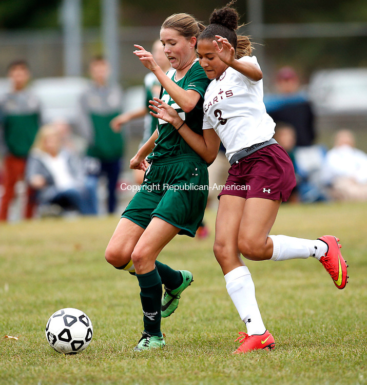 Waterbury, CT- 30 September 2015-093015CM10-  Holy Cross' Jordan Gilmore, left, and Sacred Heart's Nicole White go after the ball during their NVL matchup at Bucks Hill Park in Waterbury on Wednesday.    Christopher Massa Republican-American