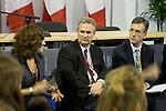 Rosa Kouri speaks with Michael Martin, the head Canadian negotiator during a meeting between the Canadian Youth Delegation and the Canadian Delegation. UNFCCC COP 14 (©Robert vanWaarden ALL RIGHTS RESERVED)