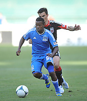 Marvin Chavez (81) of San Jose Earthquakes controls the ball against Alain Rochat (25) of D.C. United. D.C. United defeated the San Jose Earthquakes 1-0, at RFK Stadium, Saturday June 22 , 2013.