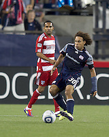 New England Revolution defender Kevin Alston (30) clears the ball. In a Major League Soccer (MLS) match, the New England Revolution defeated FC Dallas, 2-0, at Gillette Stadium on September 10, 2011.