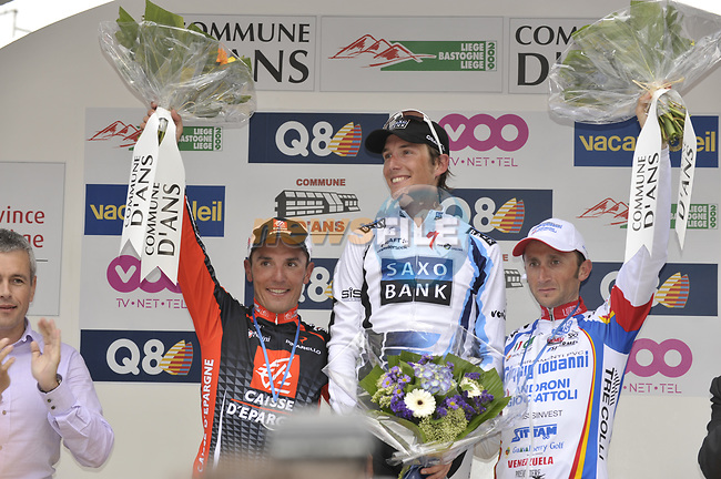 Winner Andy Schleck (LUX) Saxo Bank flanked By 2nd place rider Joaquim Rodriguez (ESP) Caisse D'Epargne and 3rd place Davide Rebellin (ITA) Serramenti-Diquigiovanni salute the huge crowd from the podium at the end of the 95th running of Liege-Bastogne-Liege cycle race, running 261km from Liege to Ans, Belgium. 26th April 2009 (Photo by Eoin Clarke/NEWSFILE)