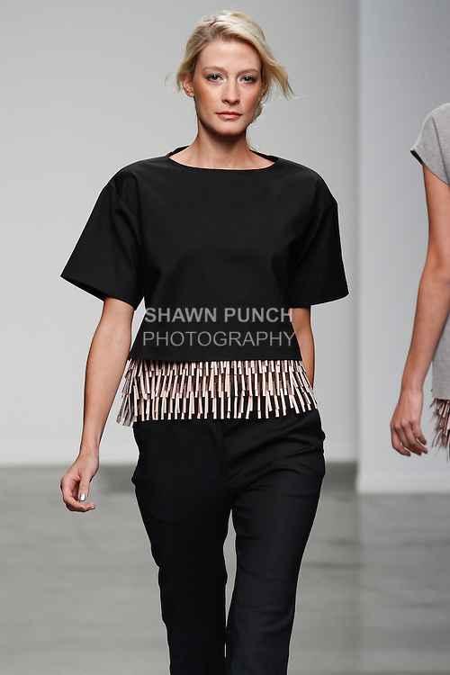 Model walks runway in an outfit from the Sachin + Babi Spring Summer 2014 collection by Sachin and Babi Ahluwalia, during New York Fashion Week Spring 2014.